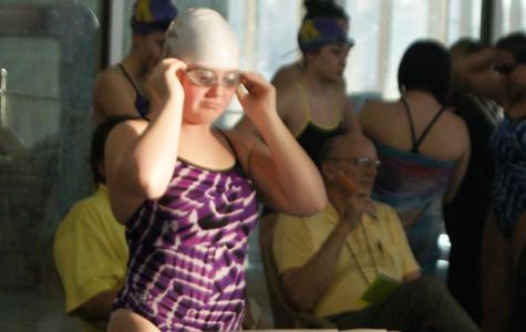 Girls' swim works on rebuilding