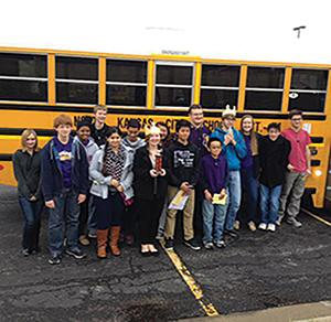 JV and Varsity Scholar Bowl teams stand next to the bus after a successful tournament in October.