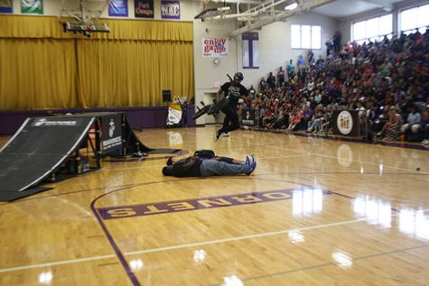 The ASA had some of the kids lay down on the floor, so they could be jumped over. In this image, the biker jumps over him, but not on his bike.