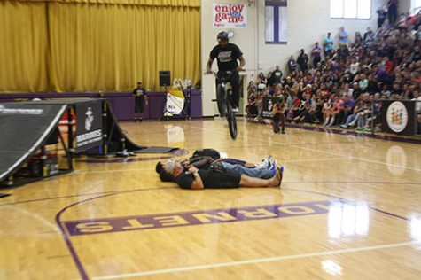 "In this image, we see the ASA jumping over the students on the floor. ""It was freaking crazy to be involved in that,"" said senior David Walker."