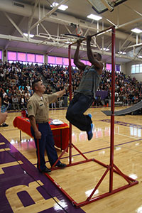 At the end of the assembly, ASA invited some students to come and break the Marine record for pull-ups, which is 37. Senior Calvin Rivers did 21.