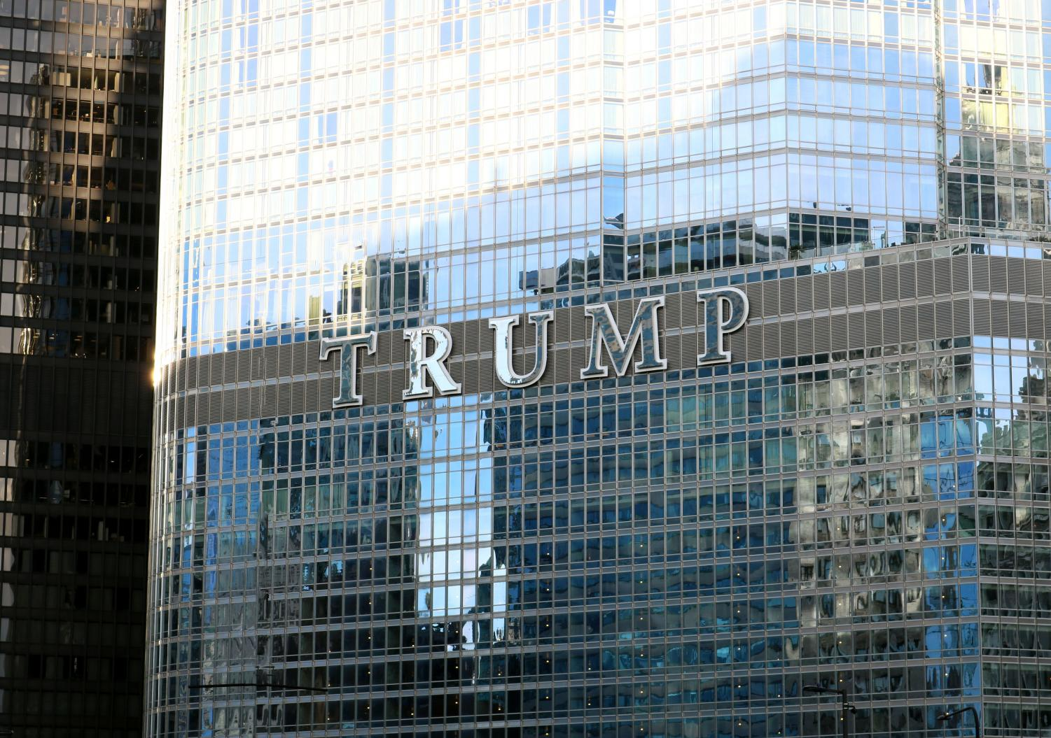 Trump tower hovers over Chicago's skyline, where the two students met.
