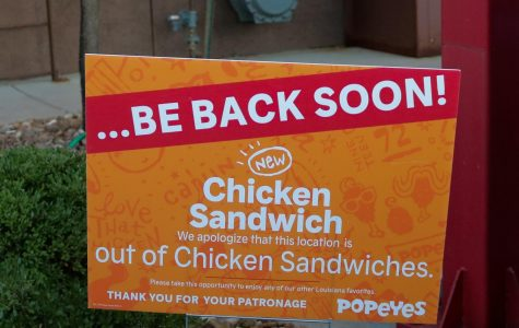 Sign outside of Popeyes informing customers of the absence. Popeyes is currently selling chicken sandwiches again.